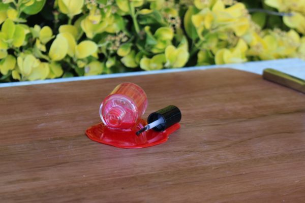 SPILLED NAIL POLISH RED CU